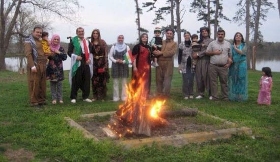 Pakhshan and group around fire