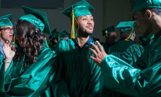 Abdullah celebrating graduation
