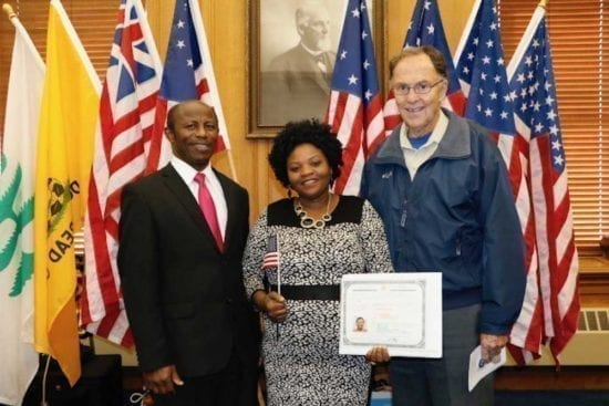 Father Jim Bream with naturalized citizens