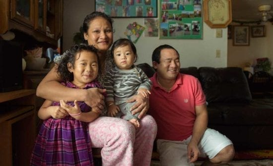 Nepali family of parents and young children (ES)