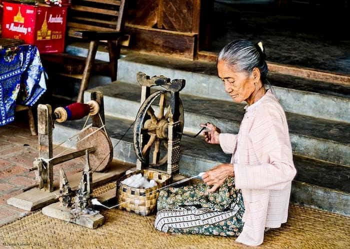 older Burmese woman with a loom