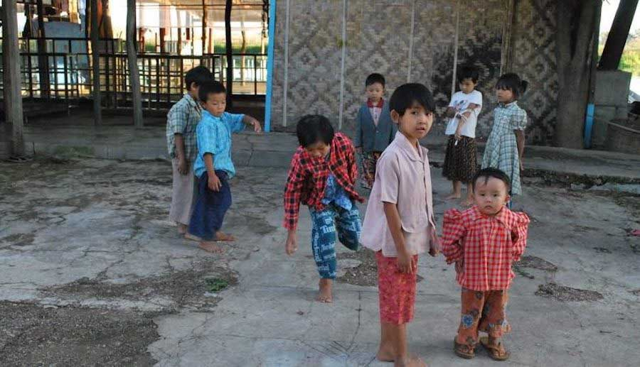 a group of Shan Burmese children palying in the street