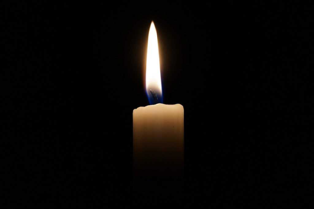 candle alight in the darkness