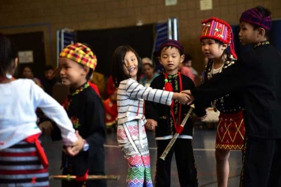 children dancing in traditional clothes