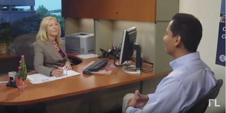 woman interviews man in citizenship test