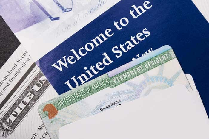closeup of permanent resident card and brochures