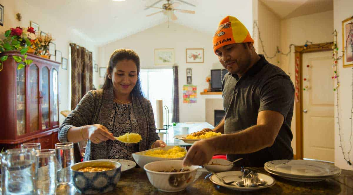 couple with home cooked meal