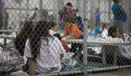 mother and children in border detention cage