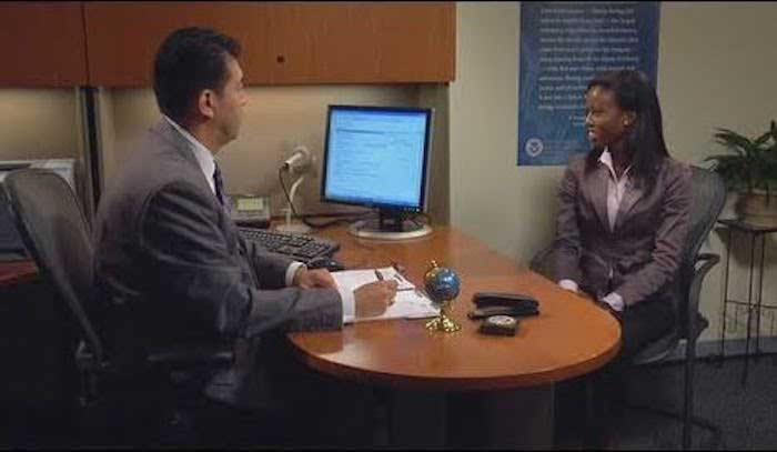 Man interviewing women in naturalization test interview