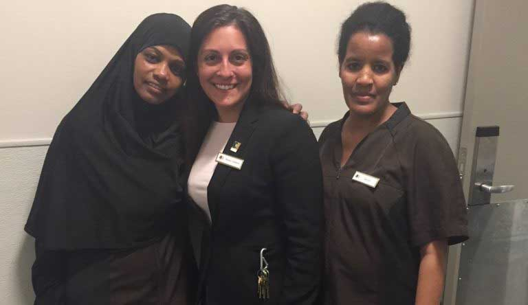 Refugee employees with HR director at a hotel