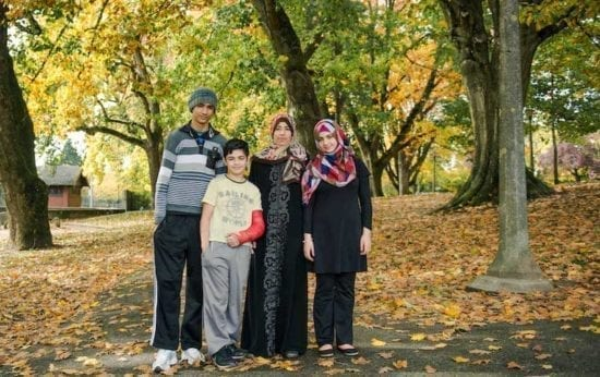 Refugee mother with her teenage kids in park