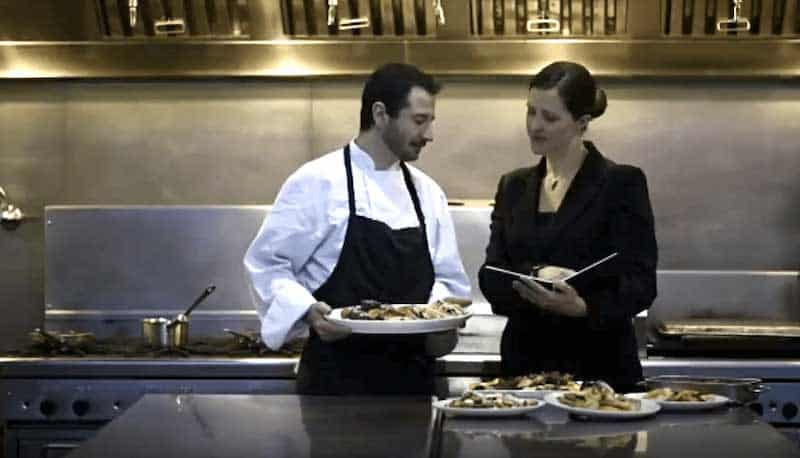 restaurant manager and chef in kitchen