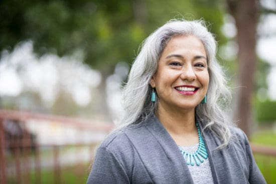 Happy-looking silver-haired woman wearing turquoise jewelry