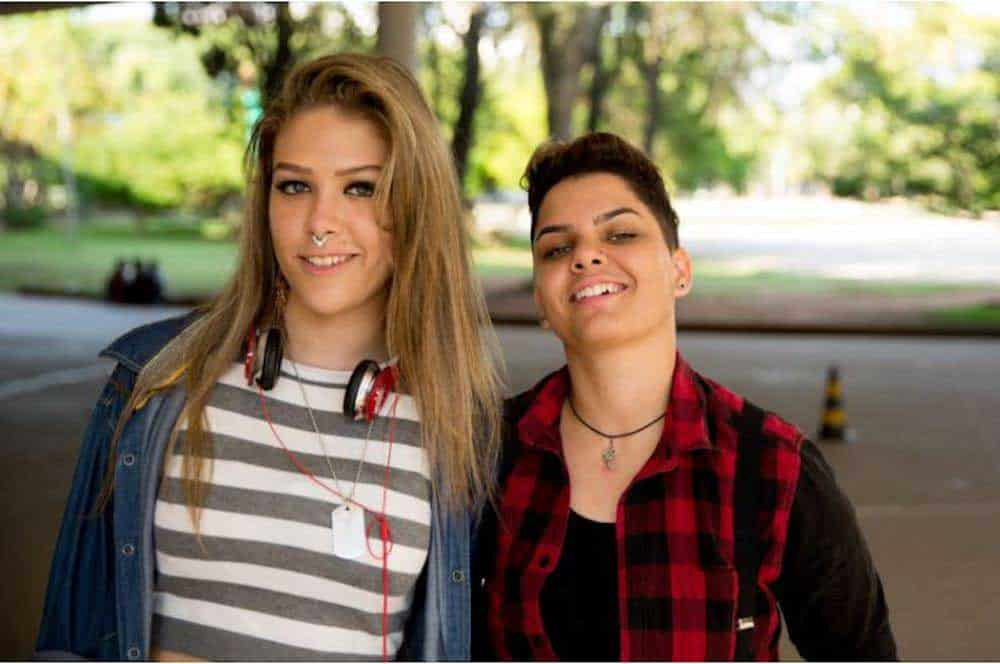 A transgender couple poses at the park