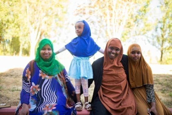 two women and two little girls in hijabs