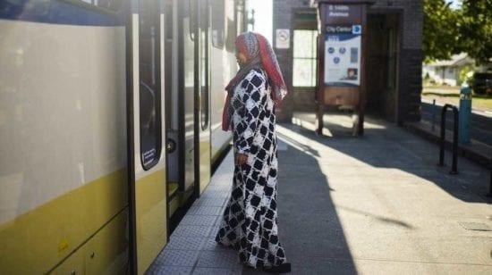 Woman boarding a city train
