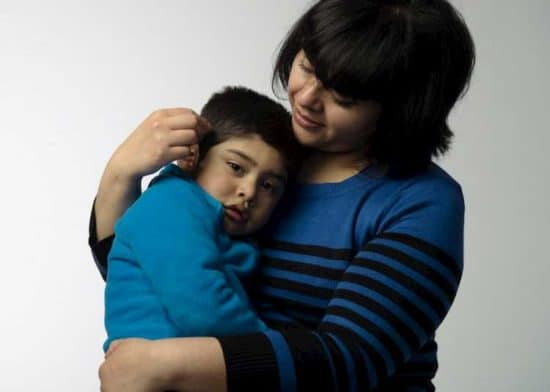 woman holds a young boy