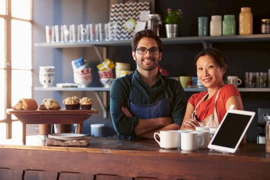 business owner couple behind food counter