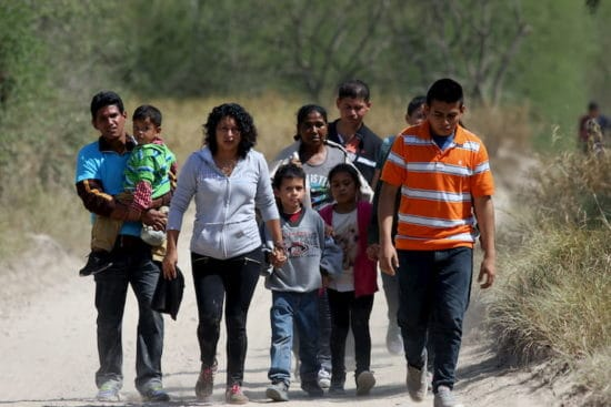 migrant family walking in rural area