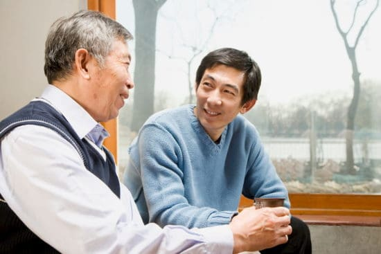 two smiling men in conversation