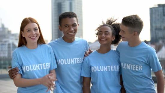 teens in volunteer tshirts