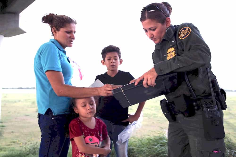 family with female border patrol