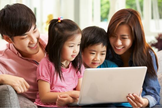 Chinese family with computer
